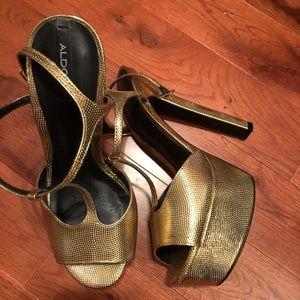 ALDO gold T strap platform heels
